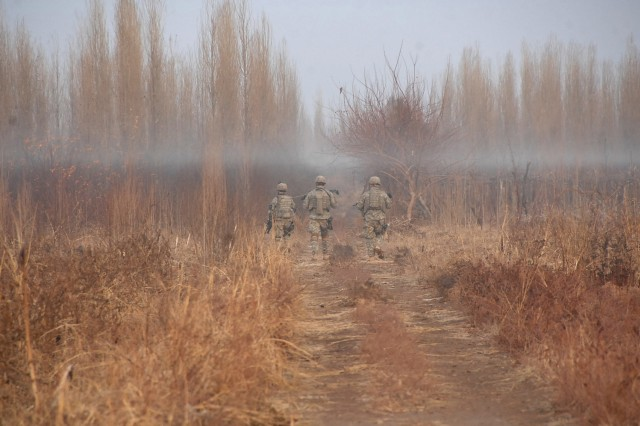Soldiers from Company B, 2nd Battalion, 23rd Infantry Regiment, 4th Brigade Combat Team, 2nd Infantry Division, patrol a rural area near Muqdadiyah, Iraq, Jan. 28.
