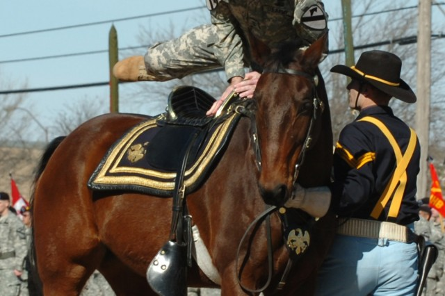 Maj. Gen. Joseph F. Fil, Jr., of Portola Valley, Calif., outgoing commander of the 1st Cavalry Division, mounts a horse to inspect his formation of troops during a ceremony on Cooper Field at Fort Hood, Texas, Feb. 1.