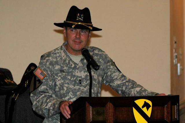 Maj. Gen. (P) Joseph F. Fil Jr., the commanding general of the 1st Cavalry Division, tears up while speaking to the Purple Heart recipients and volunteers during the 1st Cavalry Division Purple Heart and Volunteer of the Month Ceremony held Jan. 29 at the Fort Hood Conference and Catering Center. This was the last ceremony Fil would preside over prior to his relinquishment of command Feb. 1 on Cooper Field.