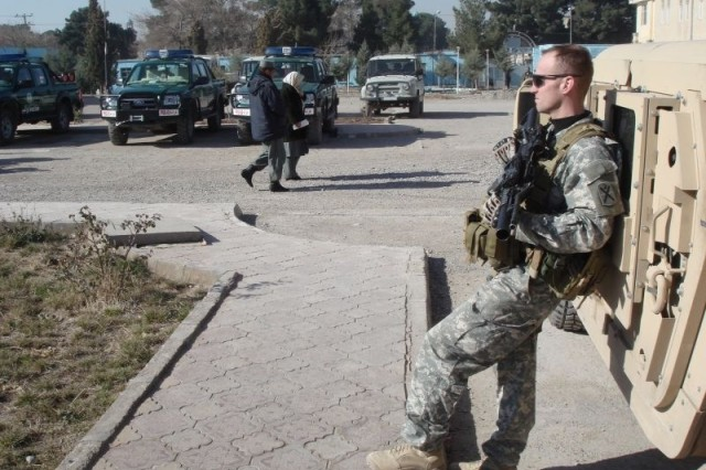 Sgt. Michael R. Tumminelli of the Communications-Electronics Research Development and Engineering Center takes a break from his training duties with the Afghan National Police in Herat, Afghanistan.