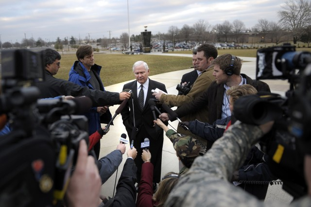 Secretary of Defense Robert M. Gates speaks with members of the press after talking confidentially with deploying troops and their spouses at Fort Campbell, Ky., Feb. 1.