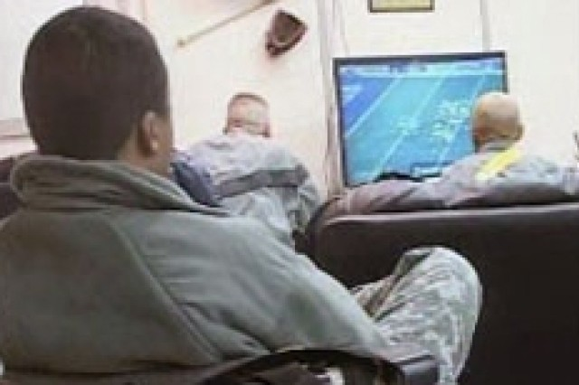 Soldiers watch the Super Bowl at Bagram Air Base, Afghanistan