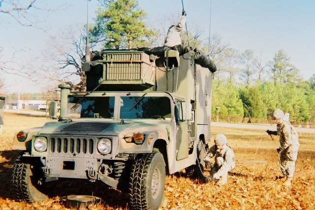 Soldiers of the Ohio National Guard's 637th Chemical Company operate the Joint Biological Point Detection System mounted on a HUMVEE in Kettering, Ohio.