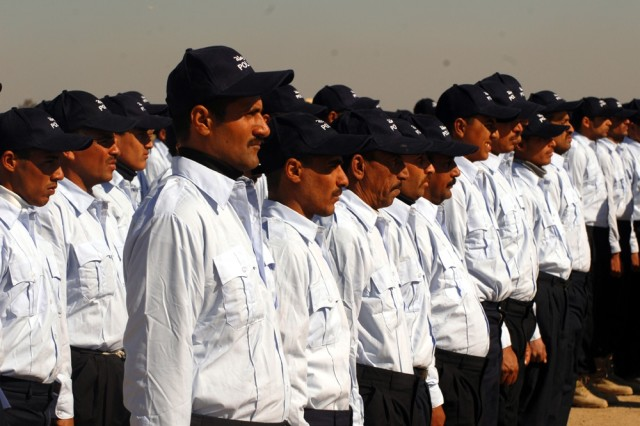 Four hundred and ninety-three Iraqi Police graduates stood in formation Feb. 2 at the Camp Fiji training facility in Baghdad to celebrate their completion of the Iraqi Police basic course.
