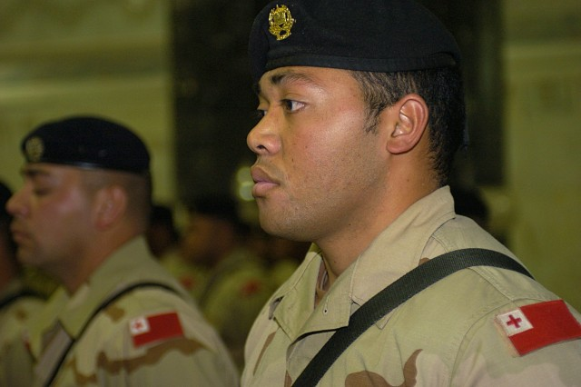 A Royal Tongan Marine stands at the position of attention during an awards ceremony held Feb 5, 2008 at the Al-Faw Palace, Camp Victory, Iraq.  The 55-man Tongan contingent deployed to Iraq in September 2007 - their Marine forces second deployment in support of Operation Iraqi Freedom -  and each member was individually awarded either U.S. Army Commendation Medals or U.S. Army Achievement Medals during the ceremony held in their honor.