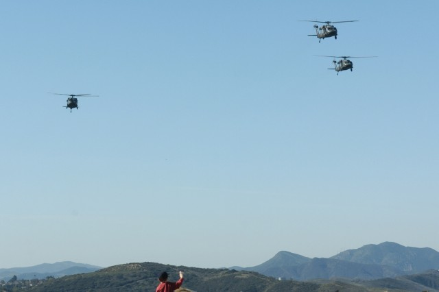 Three Blackhawk helicopters from Aviation Company, National Training Center and Fort Irwin perform a fly-over during a ceremony in honor of the 97th birthday of the late President Ronald Reagan at the Reagan Presidential Library in Simi Valley, Ca. on February 6th, 2008.