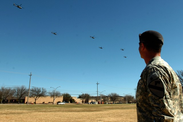 Lt. Col. Christopher Joslin, the commander of the 2nd Battalion, 227th Aviation Regiment, 1st Air Cavalry Brigade, 1st Cavalry Division, watches from Cooper Field as eight of his battalion's UH-60 Black Hawk helicopters fly over the division's parade field on their return flight to Fort Hood, Texas, Feb. 8. These helicopters recently returned to the United States via a cargo ship after completing their mission in Iraq.