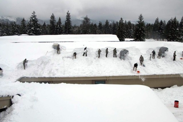 Idaho Army National Guard Soldiers from the 145th Brigade Support Battalion shovel snow off Timberlake High School Feb. 2 in Spirit Lake, Idaho. Sixty-three Guard members removed snow from the roofs of nine schools in the northern part of the state after four feet of snow crippled school systems in three counties.