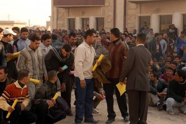 More than 1,000 Iraqi Police recruits arrive at the Furat Iraqi Police Training Center Feb. 10 to begin their Basic Recruit Training at the new facility. Following two weeks of basic law enforcement training, the recruits will be placed into the IP force in Baghdad and its surrounding provinces.