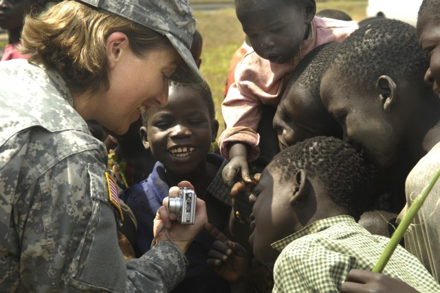 Maj. Becky Morris, commander of Company C, 486th Civil Affairs Battalion, shows children a photo she took of them during her visit to Gulu, Uganda, Jan. 23, 2008, with members of Business Executives for National Security. The members are traveling in the Combined Joint Task Force - Horn of Africa area of operations to observe and learn how their organization can integrate and contribute their resources to the mission of the task force.