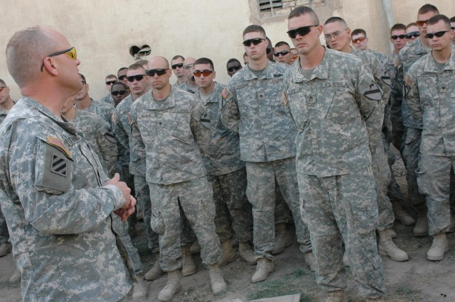 "Following the end of tour award ceremony for the Soldiers of ""Bone"" Company, 1st Squadron, 12th Combined Arms Battalion, 3rd Brigade Combat Team, 1st Cavalry Division, Oct. 24, Col. David W. Sutherland, ""Grey Wolf"" Brigade commander, speaks to the Soldiers about all they accomplished during their deployment in Baqouba, Iraq, in support of Operation Iraqi Freedom 06-08. Sutherland will be awarded the first 'No Greater Sacrifice' Freedom Award in Washington D.C., Feb. 13."