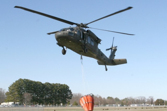 A Virginia National Guard helicopter from the 2nd Battalion, 224th Aviation lifts off from the Tazewell, Va., airport to begin firefighting operations near Center Cross, Va.