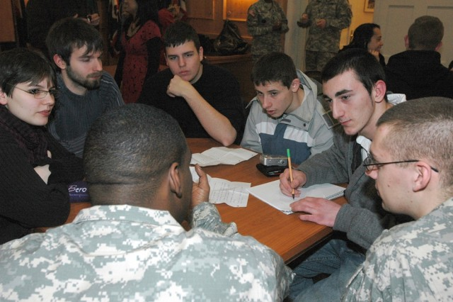 German students Jennifer Beck, left, Kyle Bernd, Sebastian Brose, Stephen Katzenberger and Alexandros Bertzenidis interview U.S. Army Garrison Heidelberg Soldiers as part of a class project on differences in everyday life and experiences.  The multimedia project will be on display at the Deutsch-Americanisches Institut in Heidelberg this summer.