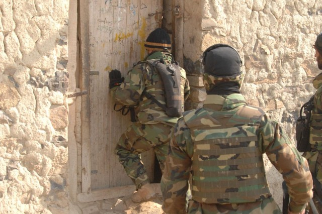 Afghan National Army Commandos from the 203rd Kandak enter a suspected insurgent safehouse during security operations in Khowst Province, Afghanistan, Feb. 7.  ""