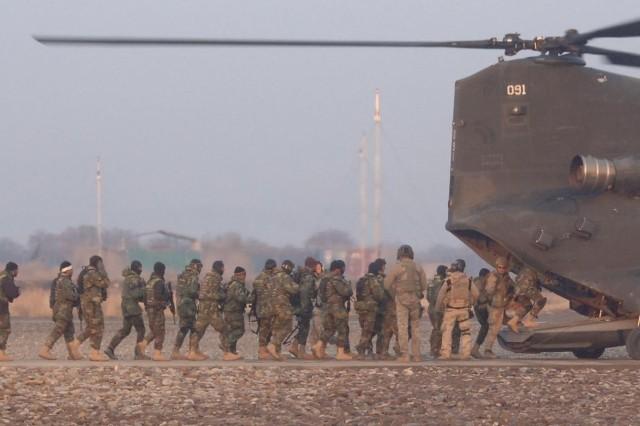 Commandos Board Coalition Copter