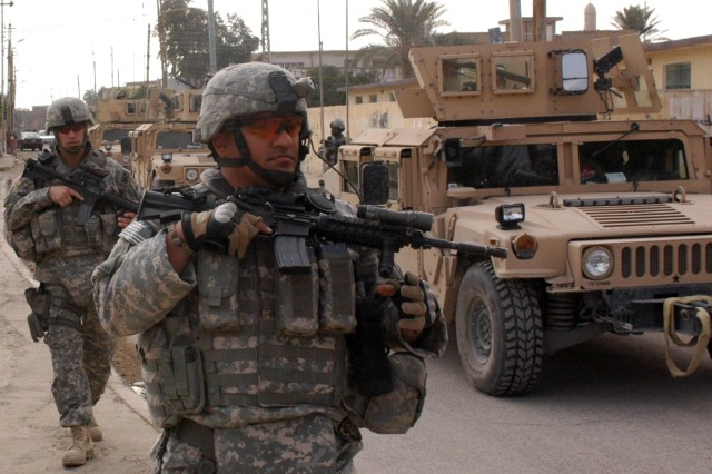 Soldiers of the 501st Military Police Company conduct a dismounted foot patrol in Tikrit, Iraq Feb. 13.