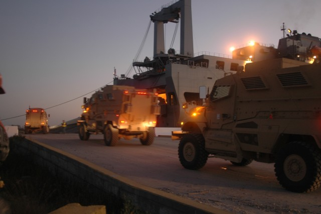 MRAPs are driven onto the USNS Pililau in Charleston, SC headed for the Middle East, Dec. 2007.