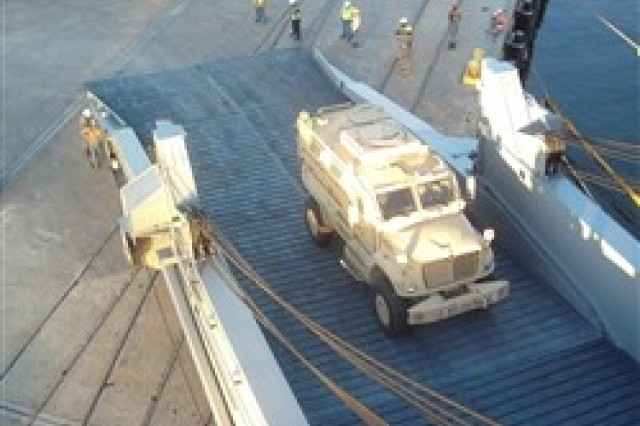 Aerial view of MRAP load onto MSC ship.