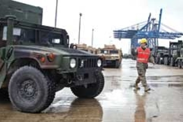 Staff Sgt. Dawn Brenner ground guides a humvee onto the USNS ALGOL for deployment - Feb. 2007.