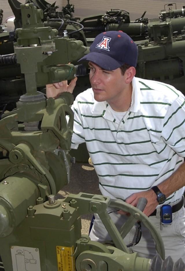 Engineer Tests Artillery System