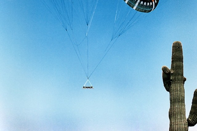 Army equipment and weapons are dropped by parachute at Yuma Proving Ground, Ariz., to test parachute systems and the ability of the test item to withstand impact. (Photo courtesy of