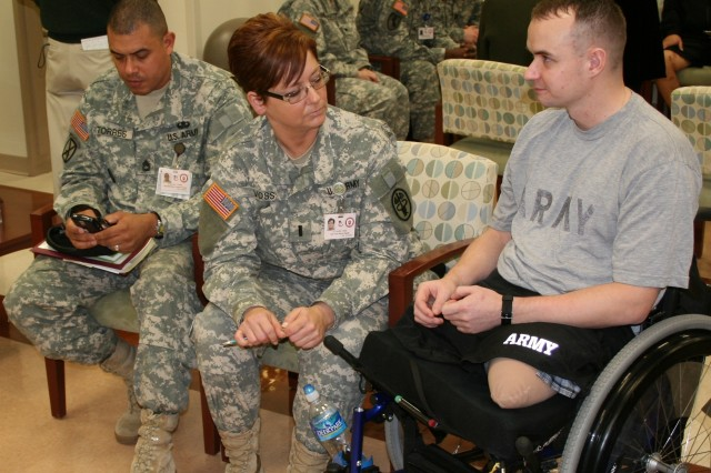Sgt. Michael Anthony Mynard talks with his nurse-case manager 1st Lt. Laurie Voss and platoon leader Sgt. 1st Class Eliseo Torres at the Warrior Clinic.