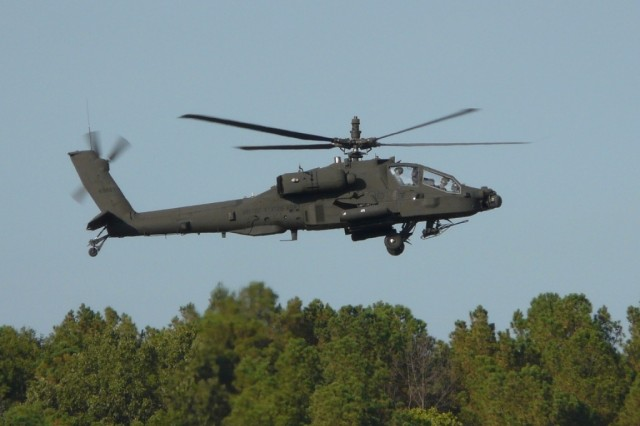 A AH-64D equipped with VUIT-2 flies over Fort Rucker, Ala. UAS video is displayed in the cockpit on the Apache LongbowAca,!a,,cs Multi-Purpose Display, and Apache Longbow sensor video can be transmitted to Soldiers on the ground.