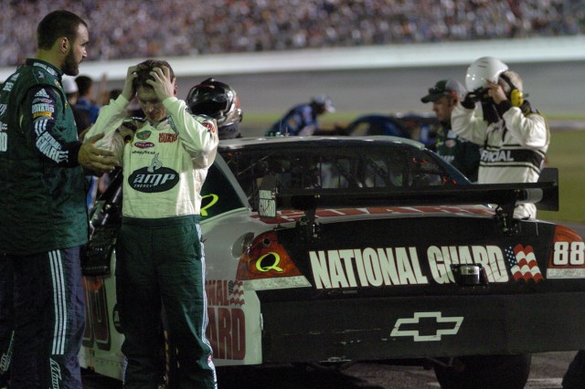 Dale Earnhardt Jr. scratches his head after climbing from the AMP Energy/National Guard car with a ninth-place finish in the 50th running of the Daytona 500 on Feb. 17 at Daytona International Speedway.