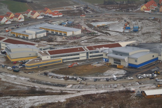 An aerial overlook flight of Germany's Grafenwoehr installation in January 2008 reveals Netzaberg Village's MILCON Island projects, including elementary and middle schools, a childcare center, a youth activity center, a chapel, ball fields, and a new infrastructure network. The U.S. Army Corps of Engineers, Europe District, is managing the construction of this project.