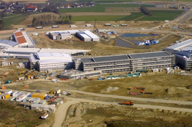 An aerial overlook flight of Germany's Grafenwoehr installation in March 2007 reveals Netzaberg Village's MILCON Island projects, including elementary and middle schools, a childcare center, a youth activity center, a chapel, ball fields, and a new infrastructure network. The U.S. Army Corps of Engineers, Europe District, is managing the construction of this project.