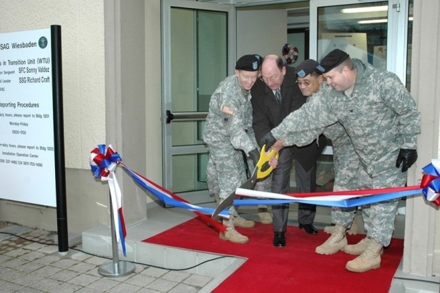 Lt. Col. Michael Doyle, Wiesbaden Health Clinic commander; Russell Hall, director of Installation Management Command-Europe; Sgt. 1st Class Sonny Valdez, Warrior Transition Unit platoon sergeant; and Col. Ray Graham, U.S. Army Garrison Wiesbaden commander, cut the ribbon to officially open the new WTU on Wiesbaden Army Airfield Feb. 5.