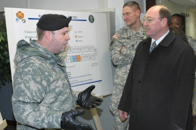 Col. Ray Graham, left, U.S. Army Garrison Wiesbaden commander, briefs Col. Keith Gallagher, commander of U.S. Army Europe Regional Medical Command, and Russell Hall, director of Installation Management Command-Europe, during the grand opening of the Warrior Transition Unit on Wiesbaden Army Airfield Feb. 5.