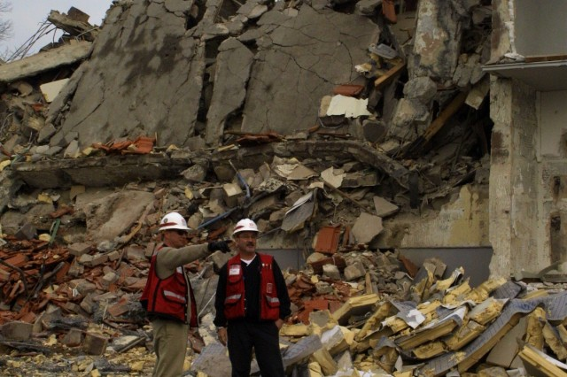 Michael Dennis (left), Wiesbaden project office quality assurance representative, updates Dave Stanton, U.S. Army Corps of Engineers Europe District safety and health manager, on the demolition of several military family housing units in Wiesbaden's Hainerberg housing area during a routine safety inspective Feb. 23, 2007. This site was cleared to make way for the construction of the upcoming Wiesbaden lodge, expected to be complete in late 2009.