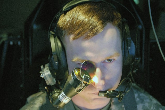 Capt. Chad Corrigan, an AH-64D Apache Longbow attack helicopter pilot and the commander of Tomahawk Troop, 4th Squadron, 3rd Armored Cavalry Regiment, focuses on a mission on the screen of a Longbow Crew Trainer at Camp Taji, Iraq.