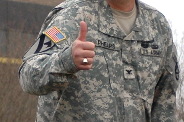 Col. Larry Phelps signals his approval moments after reviewing the Soldiers of his new command, 15th Sustainment Brigade.