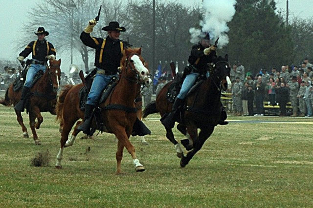 Cavalry troopers from 1st Cavalry Division's Horse Cavalry Detachment charge across Cooper Field Feb. 15 at the climax of 15th Sustainment Brigade's change of command ceremony.