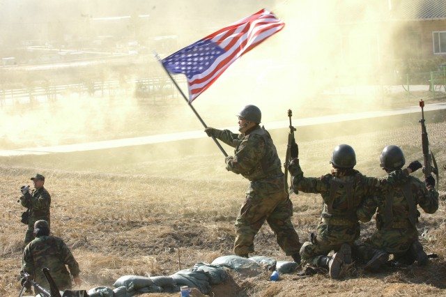 Soldiers from the ROK 20th Mech. Div. celebrate the Combined Forces' U.N. victory of the Battle of Chipyongri during a reenactment at the annual Chipyongri Memorial Ceremony in Korea Feb. 15.