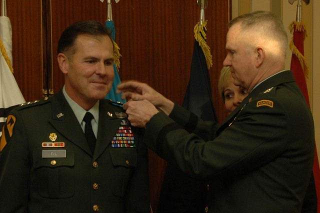 Lt. Gen. Joseph F. Fil, Jr., 1st Cavalry Division's former commanding general gets pinned with his third star by Gen. Burwell Bell, III, the U.S. Forces Korea commanding general, (right) during a promotion ceremony. Fil took over command of the 8th U.S. Army at Yongsan Garrison in South Korea Feb. 14.  He will also be acting as the U.S. Forces Korea chief of staff.