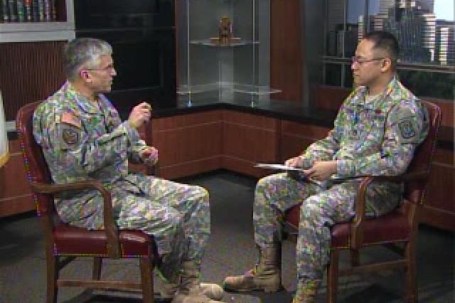 Gen. George Casey Jr. speaking with Staff Sgt. Raymond Flores