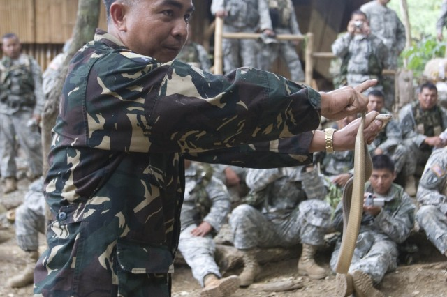 Philippine Army Staff Sgt. Manolo Martin demonstrates the proper way to hold a king cobra during the survival course Feb. 19 during Balikatan 2008.