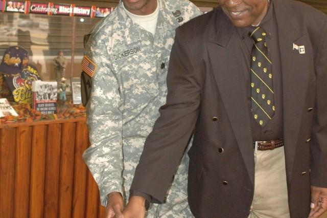 Retired Command Sgt. Maj. A.C. Cotton (right) cuts a ceremonial cake with a cavalry saber with Lt. Col. Barry Dickerson, the 1st Cavalry Division's Equal Opportunity Program manager at a Black History Month observance in the division's headquarters Feb. 21 on Fort Hood, Texas. Cotton, the guest speaker at the event and the only African American to serve as the 1st Cavalry Division command sergeant major thus far.