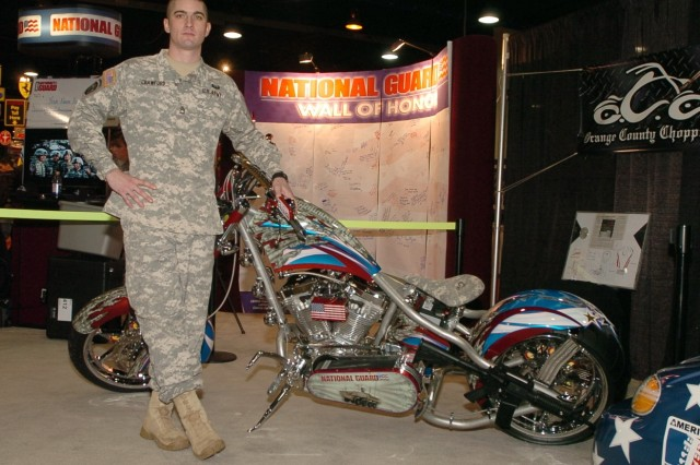 Sgt 1st Class Rich Crawford displays his Orange Country Choppers winning design at the Chicago Auto Show, Feb. 11, 2008.