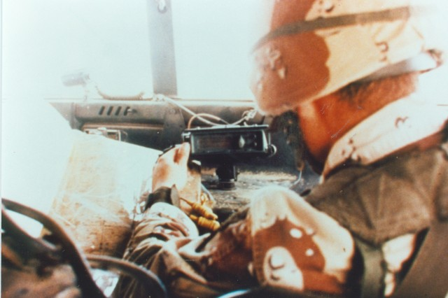Soldiers utilizing their issued SLGR which is mounted inside an	HMMWV during Operation Desert Storm.