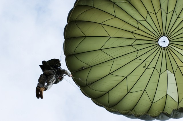 A U.S. Soldier floats high above the ground during a friendship jump between U.S. Army Special Forces and Armed Forces of the Philippines Special Operations members Feb. 22 as part of Balikatan 2008.