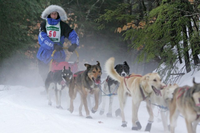 Master Sgt. Rodney Whaley, first Tennessean ever to compete in the Iditarod, makes a practice run with his team of sled dogs. The Iditarod is scheduled to begin March 1.