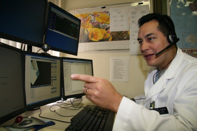 Maj. (Dr.) Pedro Lucero, eICU consultant, explains the capability of the telemedicine system installed here, the first of its kind at military medical centers.