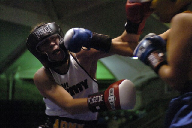 In one of two women's bouts on the 2008 Armed Forces Boxing Championships card, Army National Guard Sgt. Cherrie Retamozzo of Staten Island, N.Y., exchanges punches with UT2 Sonia Deputee of Naval Base Ventura County in Port Hueneme, Calif. Retamozzo won the bout, 34-11.