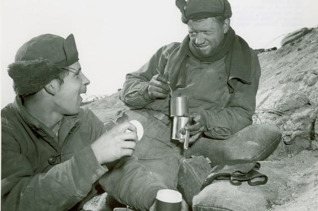 Korean Conflict - Pfc. Ronald L Johnson, Bremerton, WA (left), and Pfc. McNamara, Buffalo, NY, both of Company K, 15th Infantry Regiment, 3rd US Infantry Division, enjoy C-rations in Korea.  February 6th, 1953.