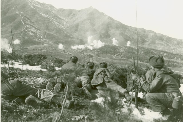 Korean Conflict - Elements of Company A and K, 35th Infantry Regiment, 25h Division, keep a sharp lookout for movement in the Communist-held area (background), as UN troops drop white phosphorous on area.  February 1st, 1951.
