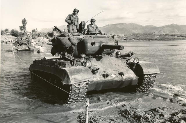 Korean Conflict - Pershing M-45 tanks cross the Kumho River on the way up to the Naktong River in Korea. September 18th, 1950.